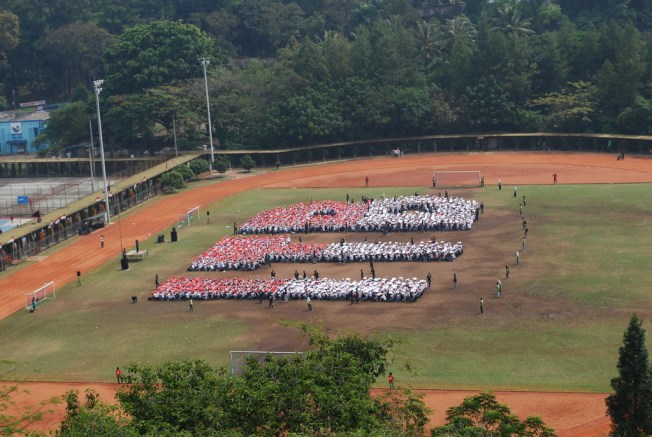 Bandung Institute of Technology (ITB) '08 generation students together form the ITB letter with red-white Indonesia's flag's color.